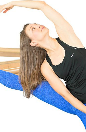 Barre Instructor Doing Graceful Pose
