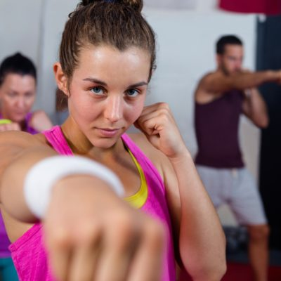 Woman throwing a punch during a boxing class at the Chicago studio