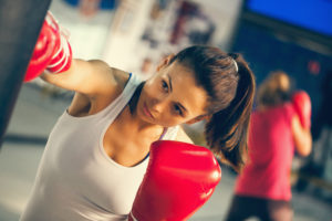 Woman teaching a female boxing class